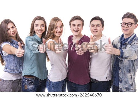 Happy smiling young group of friends with thumbs up. isolated over a white background. - stock photo