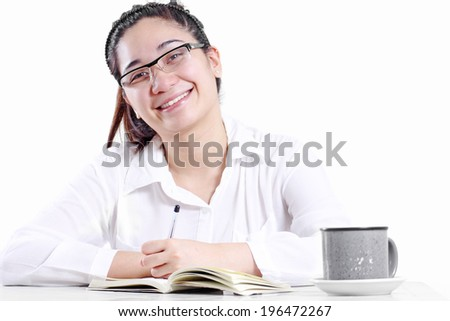 Happy smiling young lady in the office. Isolated in white background.