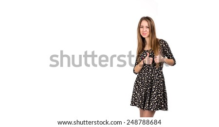 Happy smiling young lady with OK hand sign. Portrait of young Caucasian lady makes OK hand sign. Bright casual dress and white background - stock photo