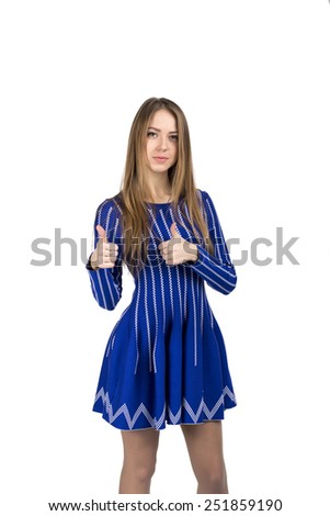 Happy smiling young lady with OK hand sign. Portrait of young Caucasian lady makes OK hand sign with both hands. Bright casual dress and white background - stock photo