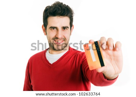 Happy smiling young man holding a credit card isolated on white background - stock photo