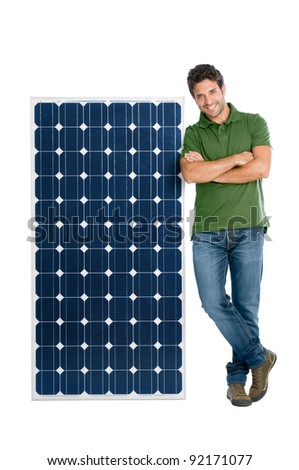 Happy smiling young man standing with a solar panel for renewable energy, isolated on white background