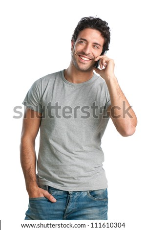 Happy smiling young man talking on mobile isolated on white background - stock photo