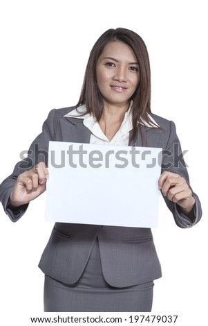 Happy smiling young pretty attractive brunette Asian business woman standing positive showing blank signboard, isolated on white background