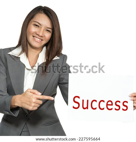"Happy smiling young pretty attractive brunette Asian businesswoman standing positive showing ""Success"" signboard, isolated on white background - stock photo"