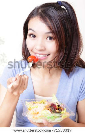 happy smiling young woman eat salad include vegetarian and fruit with home background, model is a asian cute beauty