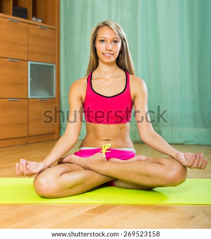 Happy smiling young woman having pilates class indoor  - stock photo
