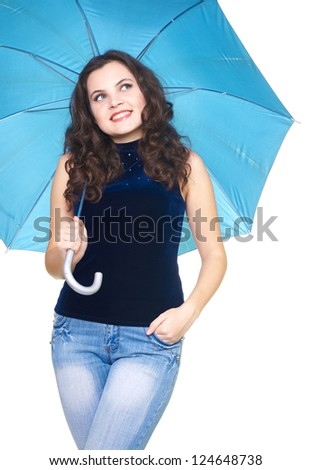 Happy smiling young woman in a blue shirt standing under a blue umbrella. Woman looking in the upper-left corner. Isolated on white background