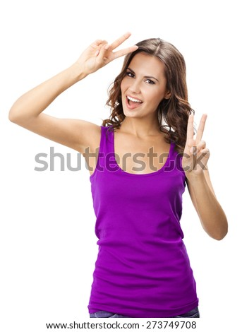 Happy smiling young woman in casual smart lilac clothing, showing two fingers or victory gesture, isolated against white background - stock photo