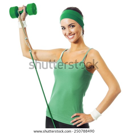 Happy smiling young woman in green fitness wear exercising with dumbbell and growth, isolated against white background - stock photo