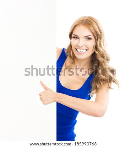 Happy smiling young woman showing blank signboard, placard or banner, with thumbs up gesture, isolated over white background - stock photo