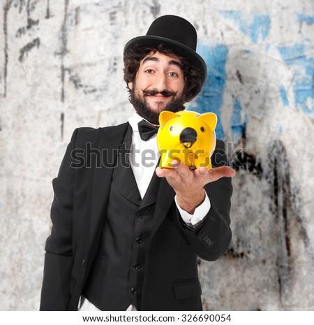 happy smoking man with piggy bank - stock photo