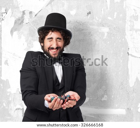 happy smoking man with poker chips - stock photo