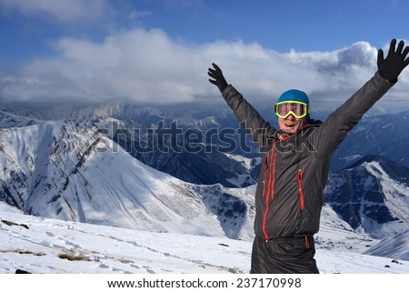 Happy snowboarder in Georgia mountains - stock photo