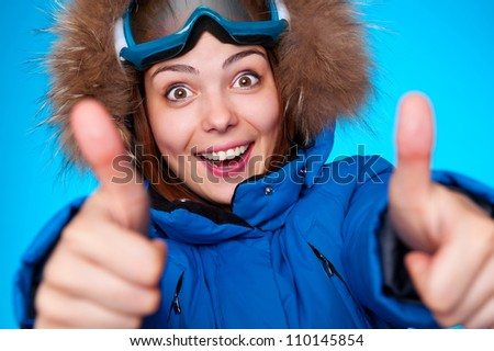 happy snowboarder smiling and showing thumbs up - stock photo