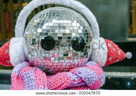 Happy snowman made from disco balls, Close up and Selective focus - stock photo