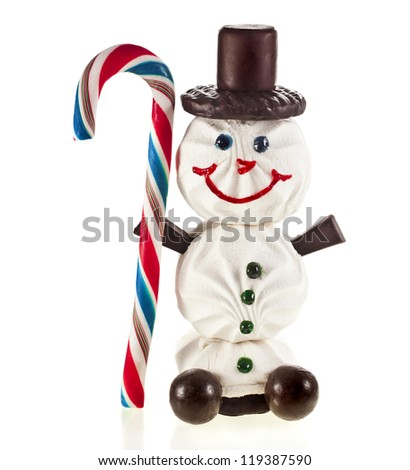 Happy snowman made of marshmallow, chocolate, candy, lollipop and jam isolated on white background