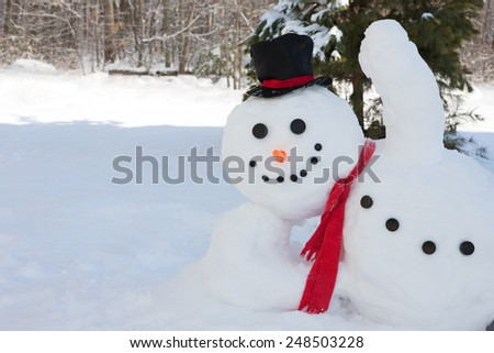 Happy snowman waving his hand