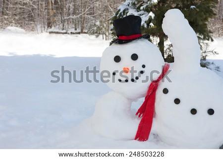 Happy snowman waving his hand - stock photo
