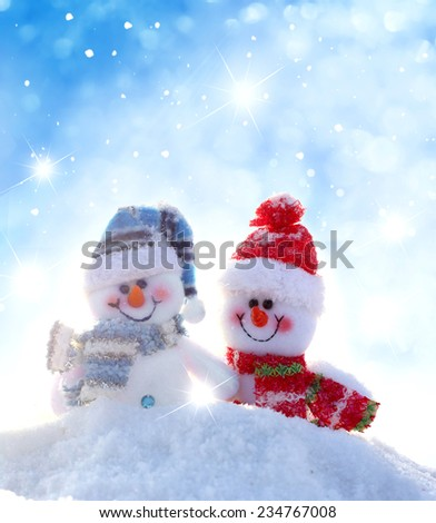 Happy snowmen .Christmas background  - stock photo