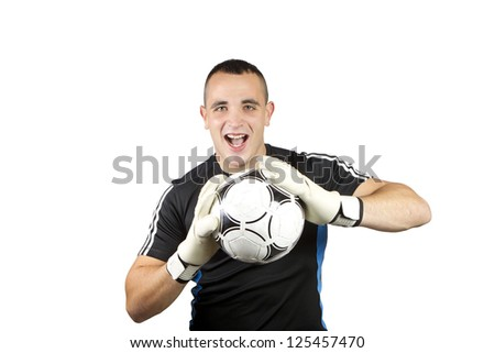 happy soccer goalkeeper ball in his hands - stock photo