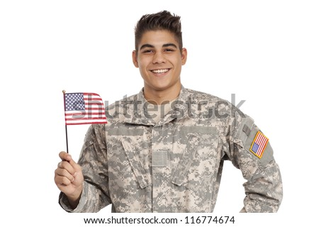 Happy soldier holding a flag - stock photo