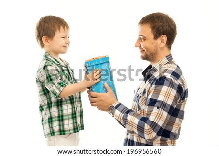Happy son gives his father gift. Isolated white background. Fathers day, family holiday, vacation. - stock photo
