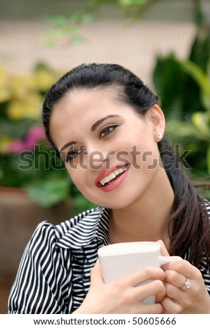 happy Spanish woman drinking coffee - stock photo