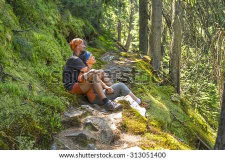 Happy sports family in the sunny forest - stock photo
