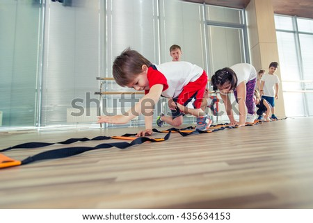 Happy sporty children in gym.