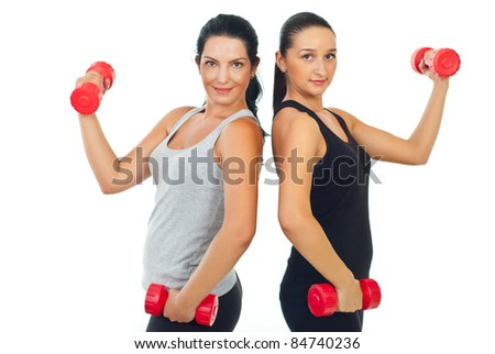 Happy sporty team of women holding barbell isolated on white background - stock photo