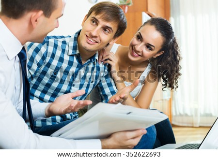 Happy spouses and positive salesman with documents