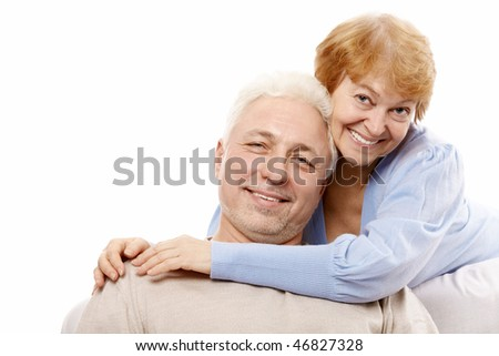 Happy spouses of advanced age on a white background - stock photo