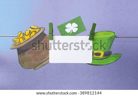 happy St Patrick's Day card, March 17, with Leprechaun hat and pot of gold, on pegs ( clothespin ) - stock photo