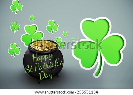 happy st patricks day against green shamrocks on grey background - stock photo