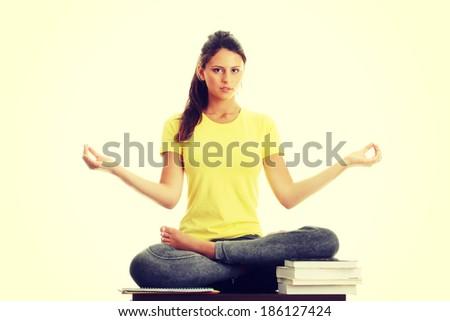 Happy student gir meditating - stock photo