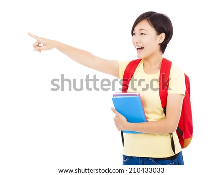 happy student girl holding books and pointing with white background