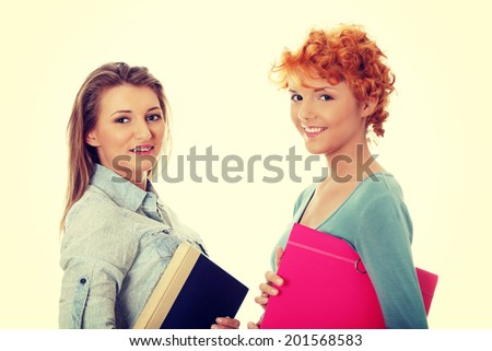Happy student girls with book