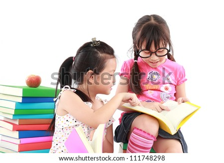 happy student little girl reading the book - stock photo