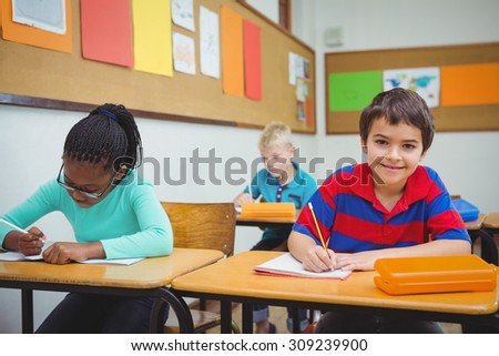 Happy student looking at the camera at the elementary school - stock photo