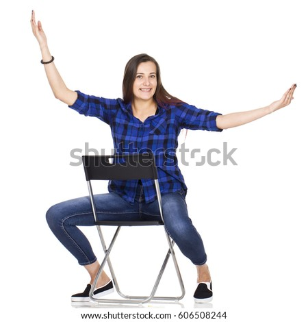 Happy student sitting on chair
