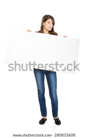 Happy student woman holding empty banner. - stock photo