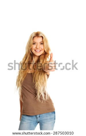 Happy student woman showing thumb up. - stock photo