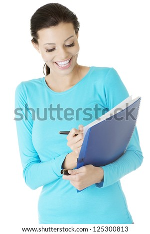 Happy student woman with notebook, isolated on white background
