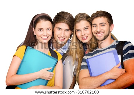 Happy students holding folders at college corridor against white background with vignette