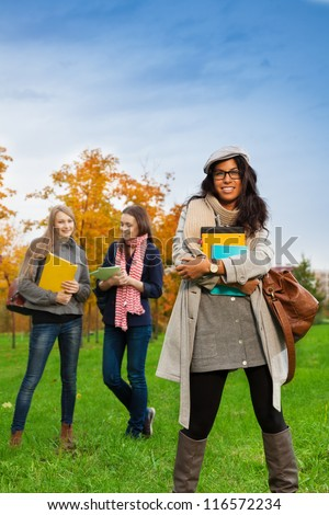 Happy students in college park - stock photo