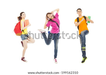 happy students listening music and jumping with books - stock photo