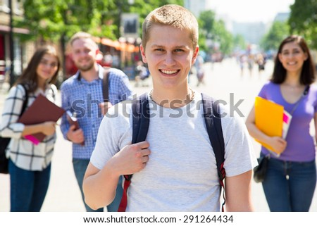Happy students outdoors with his friends