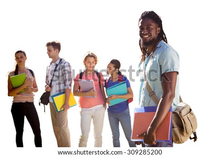 Happy students outside on campus against white background with vignette - stock photo