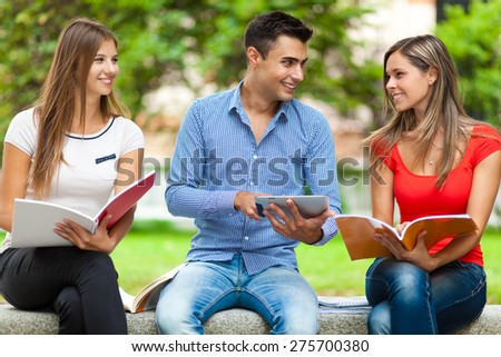 Happy students studying outdoor - stock photo